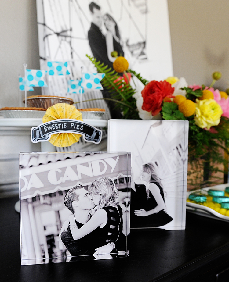 Decorate the display table or entryway with beautiful shots of the two of you.