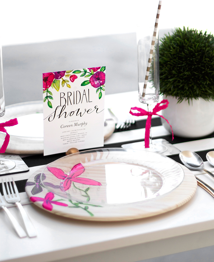 Use invitations to dress up the table, and let them inspire the rest of the party's decorative elements.