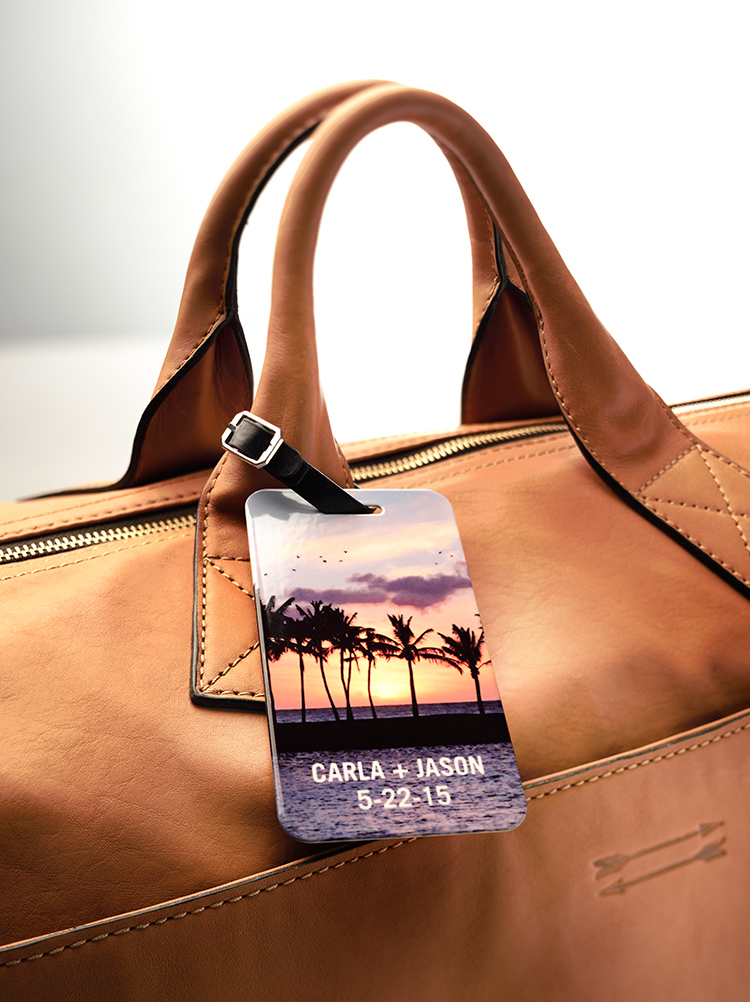 Get a fun, two-sided metal luggage tag from Shutterfly. You can personalize it with your favorite photos and more.