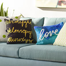 Learn 3 ways to style pillows at the Shutterfly Design Studio.
