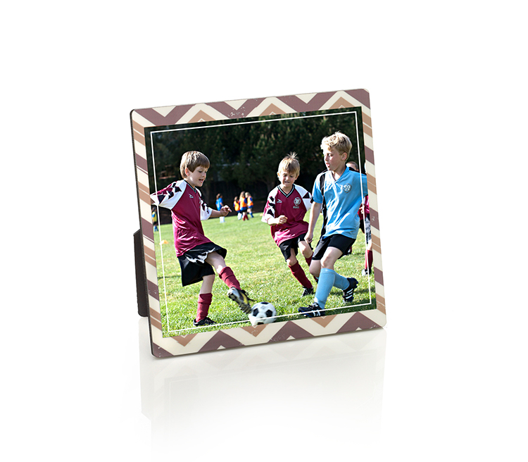 No frame required. Give coach a desktop plaque from Shutterfly that's ready to display.