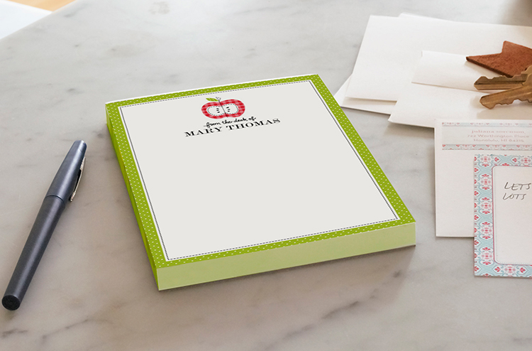 A new spin on an old favorite--an apple notepad with his or her name on it from Shutterfly.